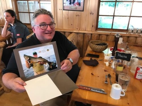 Aikens presented Tony Abena with a glossy 8 x 10 photo of his trophy lake trout